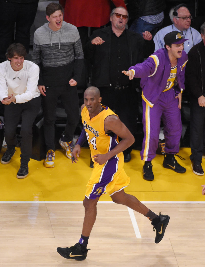 Actor Jack Nicholson, top center, cheers long with his son Ray, right, after Los Angeles Lakers forward Kobe Bryant, below, made a basket during the second half of an NBA basketball game against the Utah Jazz, Wednesday, April 13, 2016, in Los Angeles. (AP Photo/Mark J. Terrill)