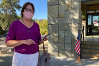 """Janet Webb, 69, stands outside the Veterans Memorial Building after voting to recall California Gov. Gavin Newsom in Lafayette, Calif., on Tuesday, Sept. 14, 2021. Webb voted for Larry Elder because of Newsom's stance on vaccine mandates. """"I am angry. It should be a freedom of choice, what is this a dictatorship? I've had it. I've never felt so angry. I'm losing all my friends and family, they don't want to have anything to do with me right now,"""" she said. (AP Photo/Jocelyn Gecker)"""