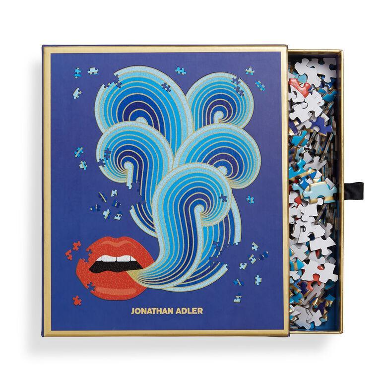 "<p><strong>Jonathan Adler</strong></p><p>jonathanadler.com</p><p><strong>$35.00</strong></p><p><a href=""https://go.redirectingat.com?id=74968X1596630&url=https%3A%2F%2Fwww.jonathanadler.com%2Fdecor-and-pillows%2Fdecor%2Fgames%2Flips-shaped-puzzle%2F29752.html%3Fgclid%3DCjwKCAjw3-bzBRBhEiwAgnnLCkok2PjmRJ6w8Bt3vlvlZSc_lKZ_sM_bPRDGz487Nevg25xXKqubgRoCd60QAvD_BwE&sref=https%3A%2F%2Fwww.cosmopolitan.com%2Flifestyle%2Fg31916628%2Fjigsaw-puzzle-for-adults%2F"" rel=""nofollow noopener"" target=""_blank"" data-ylk=""slk:Shop Now"" class=""link rapid-noclick-resp"">Shop Now</a></p><p>Anyone else weirdly turned on by this jigsaw puzzle?</p>"