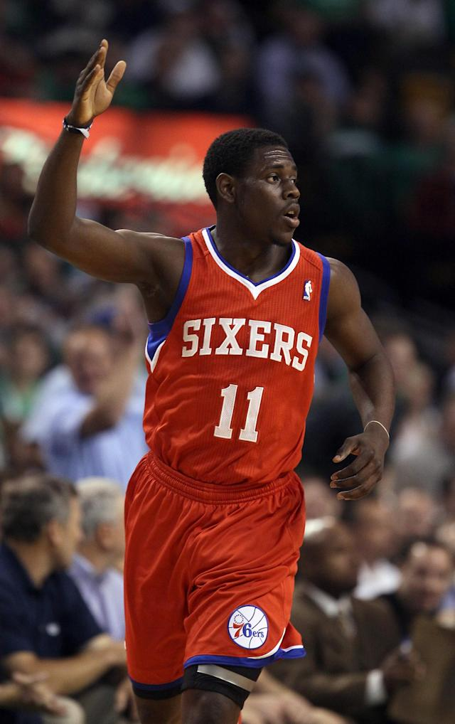 BOSTON, MA - MAY 21: Jrue Holiday #11 of the Philadelphia 76ers celebrates a shot in the first half against the Boston Celtics in Game Five of the Eastern Conference Semifinals in the 2012 NBA Playoffs on May 21, 2012 at TD Garden in Boston, Massachusetts. NOTE TO USER: User expressly acknowledges and agrees that, by downloading and or using this photograph, User is consenting to the terms and conditions of the Getty Images License Agreement. (Photo by Elsa/Getty Images)