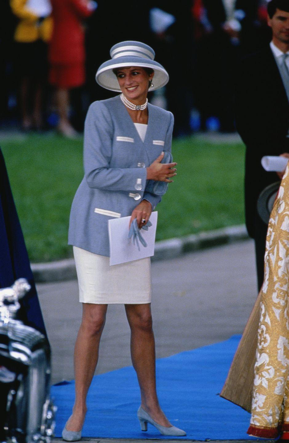 """<p>Princess Diana is seen here in a blue-and-white hat at the wedding of Princess Margaret's son David Armstrong-Jones, Viscount Linley and the Hon. Serena Stanhope.</p><p><strong><a href=""""https://www.townandcountrymag.com/society/tradition/a17007111/princess-margaret-children/"""" rel=""""nofollow noopener"""" target=""""_blank"""" data-ylk=""""slk:More: Here's What You Need to Know About Princess Margaret's Children"""" class=""""link rapid-noclick-resp"""">More: Here's What You Need to Know About Princess Margaret's Children</a></strong><br></p>"""