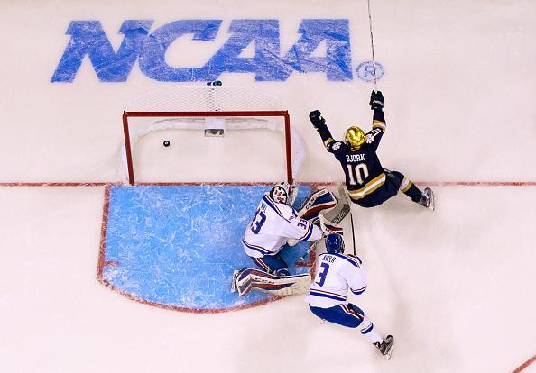 MANCHESTER, NH – MARCH 26: Anders Bjork #10 of the Notre Dame Fighting Irish celebrates a goal by teammate Cam Morrison #26 against Tyler Wall #33 of the Massachusetts Lowell River Hawks during the NCAA Division I Men's Ice Hockey Northeast Regional Championship final at the SNHU Arena on March 26, 2017 in Manchester, New Hampshire. The Fighting Irish won 3-2 in over time and advance to the Frozen Four. (Photo by Richard T Gagnon/Getty Images)