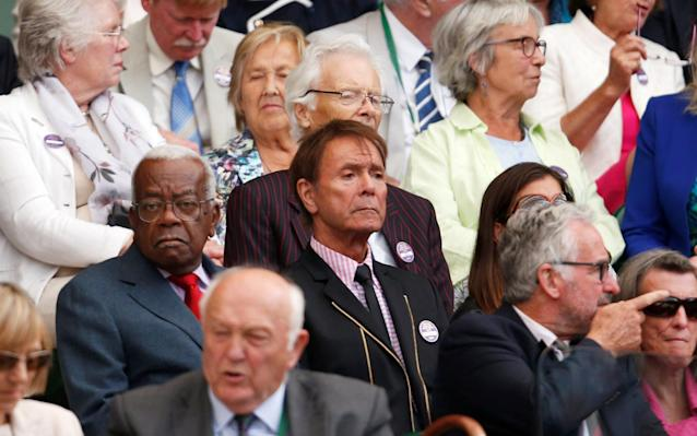 <span>Singer Cliff Richard and TV presenter Trevor McDonald take in the Federer match</span>