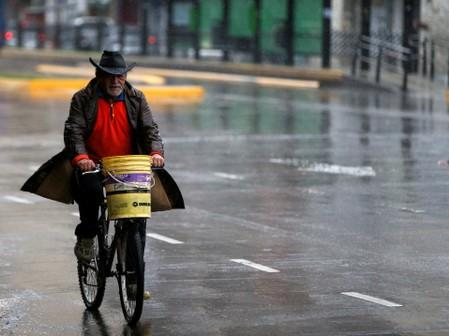 A man rides his bike during a national blackout, in Buenos Aires