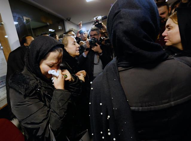 <p>Unidentified relatives of sailors who were onboard 'Sanchi' oil tanker that sunk off the coast of China mourn inside the Iranian company in Tehran, Iran, Jan. 14, 2018. (Photo: EFE/EPA/Abedin Taherkenareh) </p>