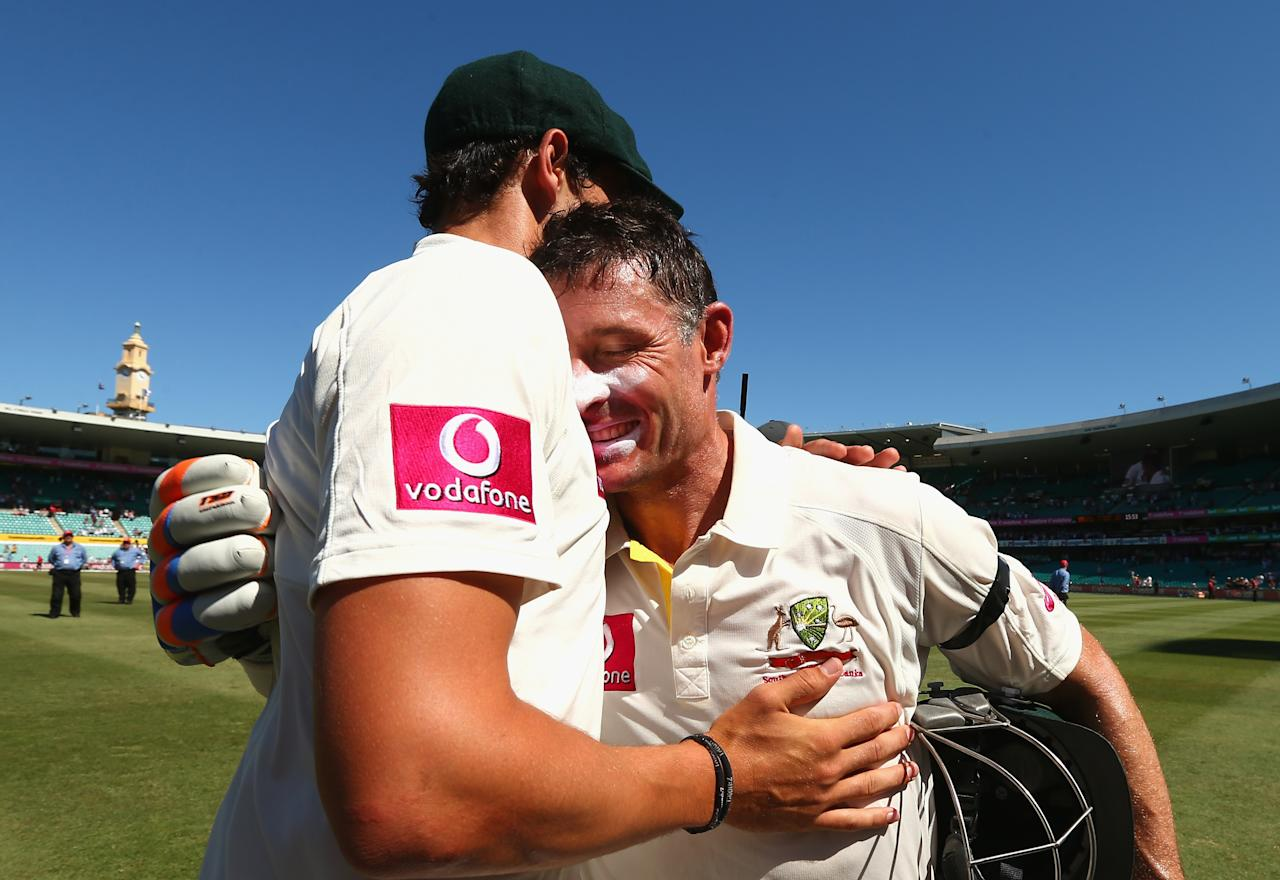 SYDNEY, AUSTRALIA - JANUARY 06:  Michael Hussey of Australia is congratulated by Mitchell Starc of Australia after his last last test match during day four of the Third Test match between Australia and Sri Lanka at Sydney Cricket Ground on January 6, 2013 in Sydney, Australia.  (Photo by Ryan Pierse/Getty Images)