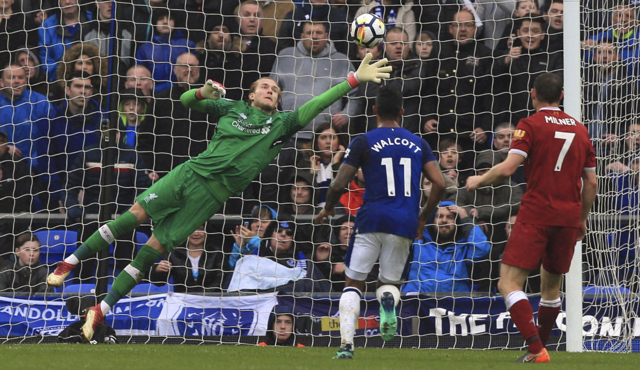 <p>Liverpool goalkeeper Loris Karius makes a save to deny Yannick Bolasie </p>