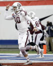 Texas A&M quarterback Kyle Allen (10) celebrates after throwing a 44-yard touchdown pass to Josh Reynolds in the first half of the Liberty Bowl NCAA college football game against West Virginia, Monday, Dec. 29, 2014, in Memphis, Tenn. (AP Photo/Mark Humphrey)