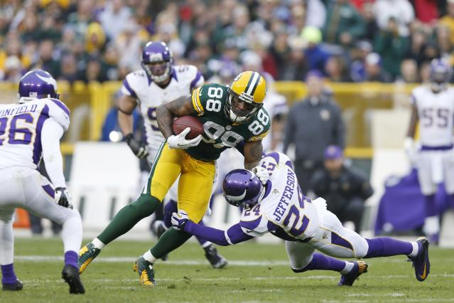 GREEN BAY, WI - DECEMBER 2: Jermichael Finley #88 of the Green Bay Packers catches a pass for a first down against A.J. Jefferson #24 of the Minnesota Vikings during the game at Lambeau Field on December 2, 2012 in Green Bay, Wisconsin. The Packers won 23-14. (Photo by Joe Robbins/Getty Images)