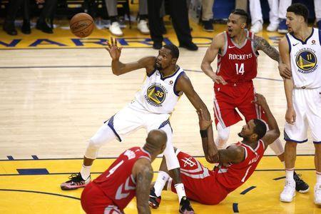 May 26, 2018; Oakland, CA, USA; Golden State Warriors forward Kevin Durant (35) battles for the ball with Houston Rockets forward Trevor Ariza (1) in game six of the Western conference finals of the 2018 NBA Playoffs at Oracle Arena. Mandatory Credit: Cary Edmondson-USA TODAY Sports