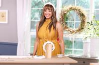 <p>Tamera Mowry-Housley gets ready to work on the set of Hallmark Channel's <em>Home & Family</em> at Universal Studios Hollywood on Wednesday.</p>