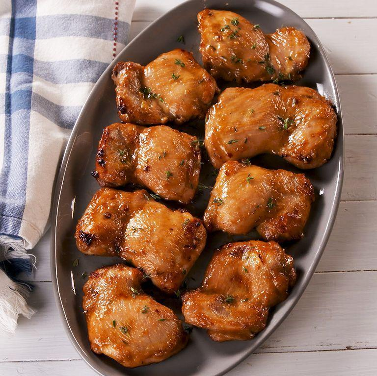 """<p>Chicken has a terrible reputation for drying out in the oven, but with chicken thighs you don't need to worry. These boneless chicken thighs first get marinated in an easy honey mustard-esque sauce that makes them so juicy and flavourful.</p><p>Get the <a href=""""https://www.delish.com/uk/cooking/recipes/a30243964/how-to-cook-boneless-chicken-thigh-oven-recipe/"""" rel=""""nofollow noopener"""" target=""""_blank"""" data-ylk=""""slk:Baked Boneless Chicken Thighs"""" class=""""link rapid-noclick-resp"""">Baked Boneless Chicken Thighs</a> recipe.</p>"""