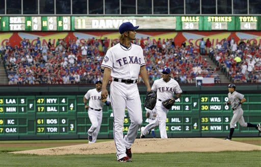 Texas Rangers' Yu Darvish of Japan walks off the field after getting the final out in the top of the first inning of a baseball game Monday, April 9, 2012, in Arlington, Texas. Darvish needed 41 pitches giving up four runs in the inning. (AP Photo/Tony Gutierrez)