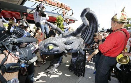 """A figure of Toothless the Dragon character walks on the Croisette during a photocall for the film """"How to Train Your Dragon 2"""" at the 67th Cannes Film Festival in Cannes"""
