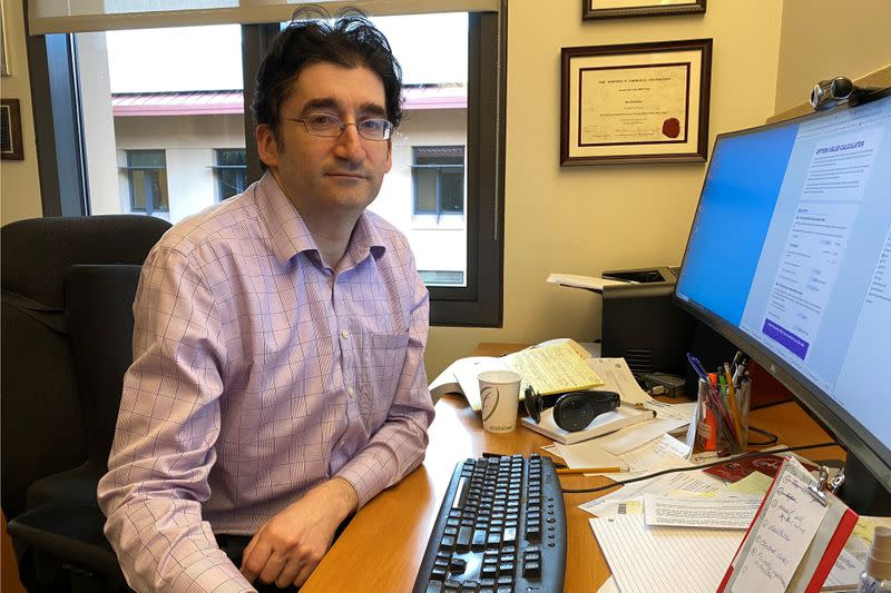 Stanford Graduate School of Business professor Ilya Strebulaev poses while showing a new online calculator