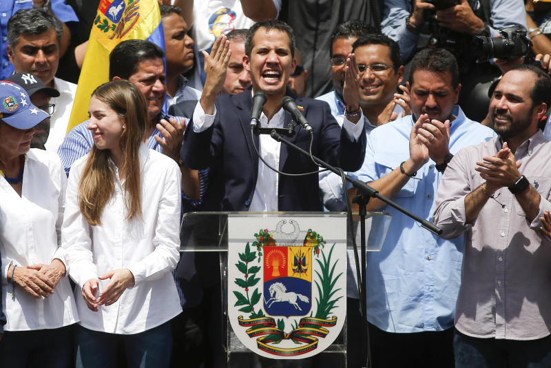 Venezuelan Congress President Juan Guaido, an opposition leader who declared himself interim president, speaks during a rally demanding the resignation of Venezuelan President Nicolas Maduro, next to his wife Fabiana Rosales in Caracas, Venezuela, Monday, March 4, 2019. The United States and about 50 other countries recognize Guaido as the rightful president of Venezuela, while Maduro says he is the target of a U.S.-backed coup plot (AP Photo/Eduardo Verdugo)
