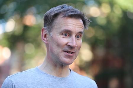 PM hopeful Jeremy Hunt returns after an early morning run in London