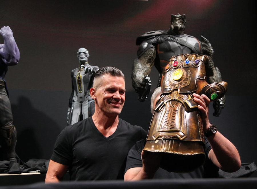 <p>Josh Brolin (left) visits the Marvel booth at D23 Expo 2017, showing off Thanos's Infinity Gauntlet prop (with all the stones intact) from Avengers: Infinity War , one of three films Marvel had in its exhibit, along with Black Panther and Thor: Ragnarok . (Disney/Image Group LA) </p>