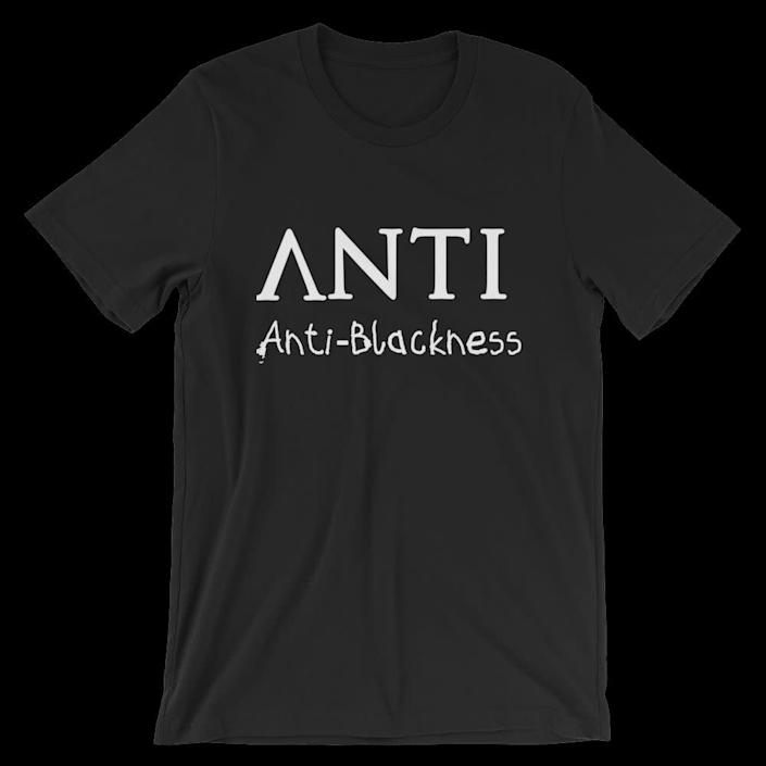 "Get the <a href=""https://www.blackbourgeois.com/products/anti-unisex-tee-1"" rel=""nofollow noopener"" target=""_blank"" data-ylk=""slk:&quot;ANTI&quot; unisex tee from Black Bourgeois for $25"" class=""link rapid-noclick-resp"">""ANTI"" unisex tee from Black Bourgeois for $25 </a>"