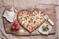 "<p>If you want to cook this year, make a heart-shaped pizza yourself! Many grocery stores like <a href=""https://www.wholefoodsmarket.com/"" rel=""nofollow noopener"" target=""_blank"" data-ylk=""slk:Whole Foods"" class=""link rapid-noclick-resp"">Whole Foods</a> and <a href=""https://www.publix.com/"" rel=""nofollow noopener"" target=""_blank"" data-ylk=""slk:Publix"" class=""link rapid-noclick-resp"">Publix</a> offer fresh pizza dough for sale. Simply shape the dough into a heart, add any toppings your heart (heh) desires, and bake as directed. </p>"