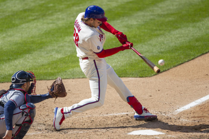 Philadelphia Phillies Alec Bohm (28) hits an RBI single during the eighth inning of a baseball game against the Atlanta Braves, Sunday, April 4, 2021, in Philadelphia. (AP Photo/Laurence Kesterson)