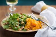 "Tangled butternut ribbons get baked into a moist flat cake for a seriously showstopping side. Pair the squash with a mix of spicy arugula and ever-so-slightly-bitter chicory enhanced with savory pancetta and toasted hazelnuts. A sweet-tart apple vinaigrette is the final touch atop the refreshing fall salad. <a href=""https://www.epicurious.com/recipes/food/views/roasted-butternut-squash-ribbons-with-arugula-pancetta-and-hazelnut-salad-51138000?mbid=synd_yahoo_rss"" rel=""nofollow noopener"" target=""_blank"" data-ylk=""slk:See recipe."" class=""link rapid-noclick-resp"">See recipe.</a>"