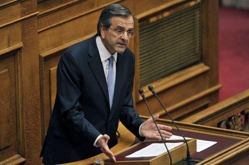 New Greek Prime Minister Antonis Samaras speaks at the Greek parliament in Athens as he presents his government's targets for the next four years, during which he pledged to push through a major privatisation drive and keep Greece in the eurozone. Samaras asked EU-IMF creditors for more time for a tough bailout programme, to ease the pain on an economy struggling in its fifth year of recession