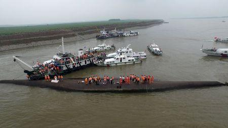 An aerial view shows rescue workers searching on the sunken ship at Jianli section of Yangtze River, Hubei province, China, June 2, 2015. REUTERS/Stringer