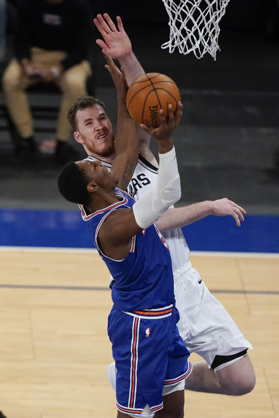 New York Knicks' RJ Barrett, left, drives past San Antonio Spurs' Jakob Poeltl during the second half of an NBA basketball game Thursday, May 13, 2021, in New York. (AP Photo/Frank Franklin II, Pool)