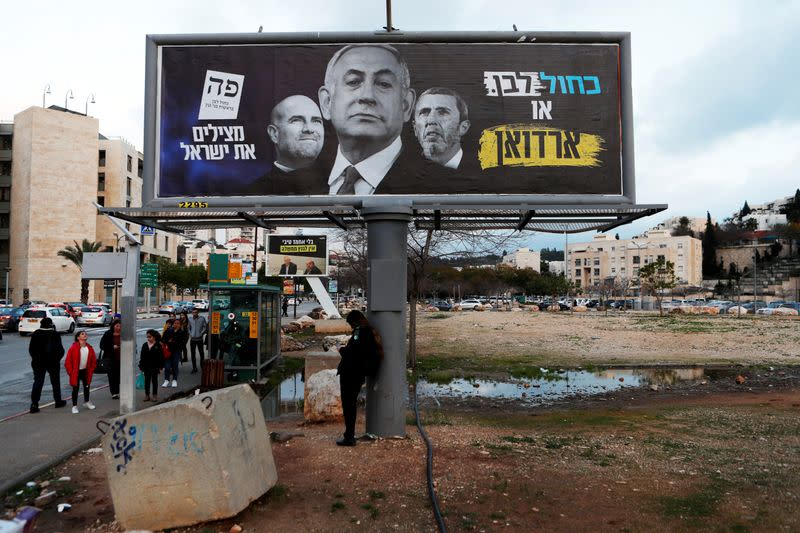 A Blue and White party election campaign banner depicting Israeli Prime Minister Benjamin Netanyahu is seen in Modiin, Israel