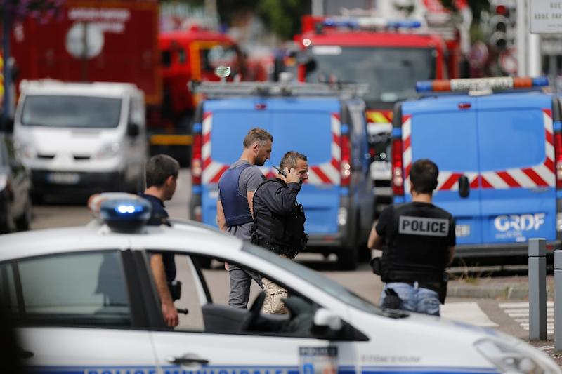 Emergency services arrive at the scene of a hostage-taking at a church in Saint-Etienne-du-Rouvray, near Rouen in northern France, on July 26, 2016 (AFP Photo/Charly Triballeau)