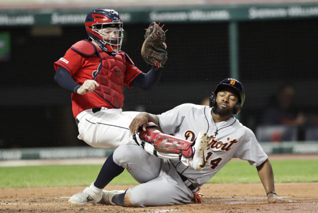 Cleveland Indians catcher Roberto Perez tags out Detroit Tigers' Christin Stewart, right, at home in the fourth inning in a baseball game, Wednesday, Sept. 18, 2019, in Cleveland. (AP Photo/Tony Dejak)