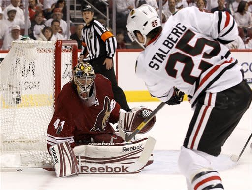 Chicago Blackhawks' Viktor Stalberg (25), of Sweden, sends a shot at Phoenix Coyotes' Mike Smith (41), who makes the save, during the second period in Game 5 of an NHL hockey Stanley Cup first-round playoff series Saturday, April 21, 2012, in Glendale, Ariz.AP Photo/Ross D. Franklin)