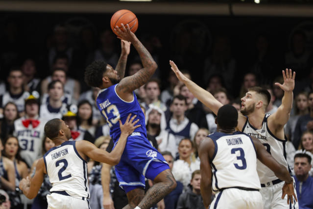 Seton Hall guard Myles Powell (13) shoots over Butler guard Aaron Thompson (2), guard Kamar Baldwin (3) and forward Bryce Golden (33) in the first half of an NCAA college basketball game in Indianapolis, Wednesday, Jan. 15, 2020. (AP Photo/Michael Conroy)