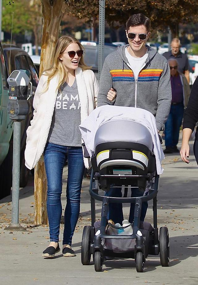 """<p>Grace and his actress wife, Ashley Hinshaw, were spotted Sunday leaving a Mommy & Me class with their <a href=""""https://www.yahoo.com/entertainment/topher-grace-dad-actor-wife-010503888.html"""" data-ylk=""""slk:2-month-old daughter, Mabel;outcm:mb_qualified_link;_E:mb_qualified_link"""" class=""""link rapid-noclick-resp"""">2-month-old daughter, Mabel</a>, in tow in Studio City, Calif. Hinshaw wore a cute T-shirt that read """"Mama Bear."""" (Photo: Mega Agency) </p>"""