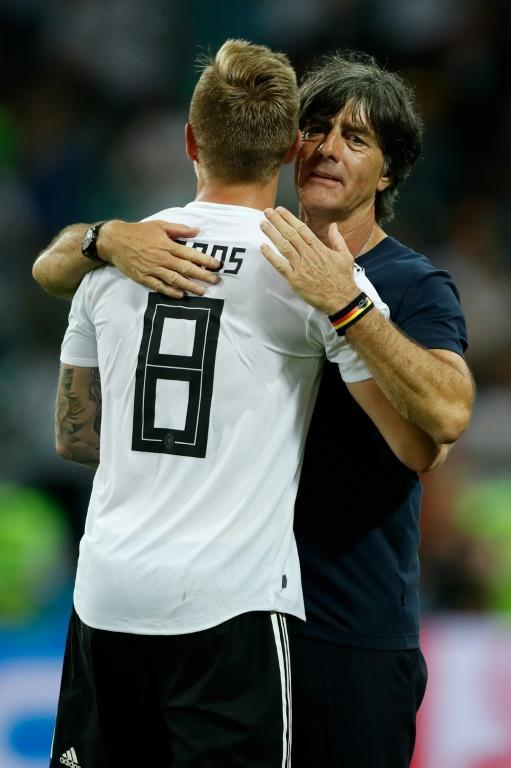 Toni Kroos and Germany coach Joachim Loew embrace at the end of Saturday's game