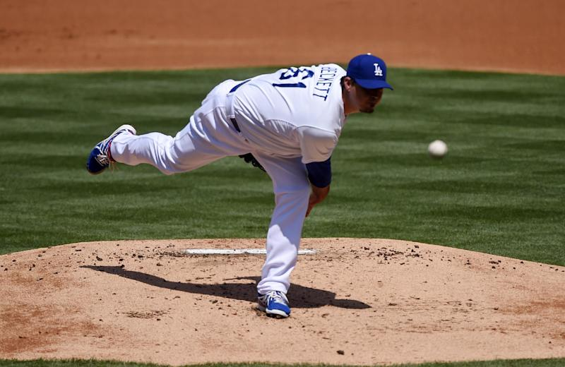 Los Angeles Dodgers starting pitcher Josh Beckett throws to the plate during the second inning of a baseball game against the Arizona Diamondbacks, Sunday, April 20, 2014, in Los Angeles. (AP Photo/Mark J. Terrill)