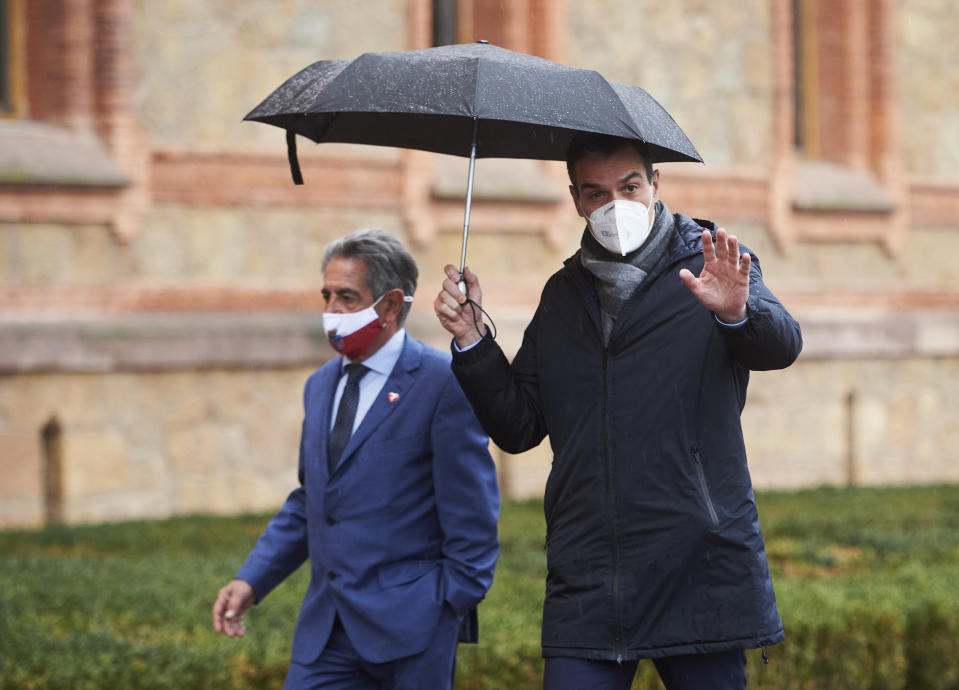 COMILLAS, SPAIN – DECEMBER 4: The President of Cantabria, Miguel Ángel Revilla (l), next to the President of the Government of Spain, Pedro Sánchez, on his arrival at the Chapel of the Major Seminary of Comillas, on December 4, 2020, in Cantabria, Spain. Sánchez has traveled to Cantabria to present the Plan for the Recovery, Transformation and Resilience of the Economy in an event to be held in the Chapel of the Seminary of Comillas. (Photo by Juan Manuel Serrano Arce/Europa Press via Getty Images)