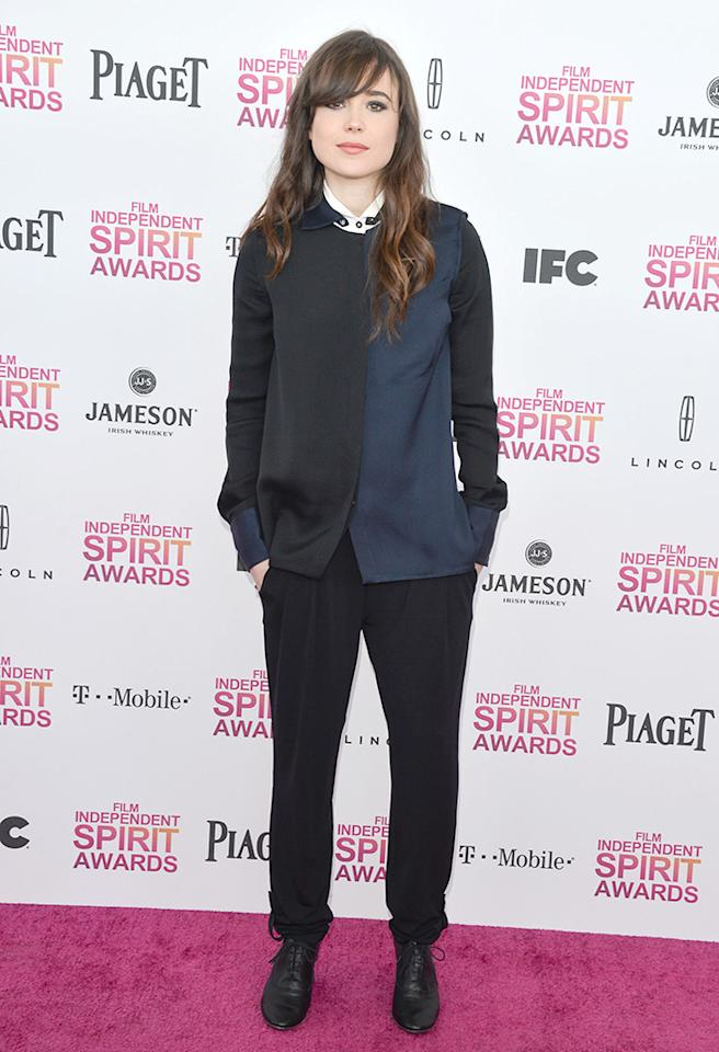 """Following in Cooper's footsteps on the pink carpet at the 2013 Indie Spirit Awards was """"Juno"""" alum Ellen Page, who failed to impress in a bipolar Derek Lam blouse, baggy Armani trousers, and witch booties. (2/23/2013)"""