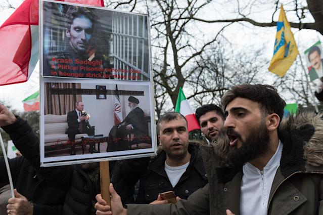 <p>A group of demonstrators associated with National Council of Resistance of Iran (NCRI) gather outside the Iranian Embassy in London to show solidarity with anti-government protesters in Iran and demand an end to the Islamic Republic and the Iranian establishment, Jan. 6, 2018. (Photo: Wiktor Szymanowicz/REX/Shutterstock) </p>