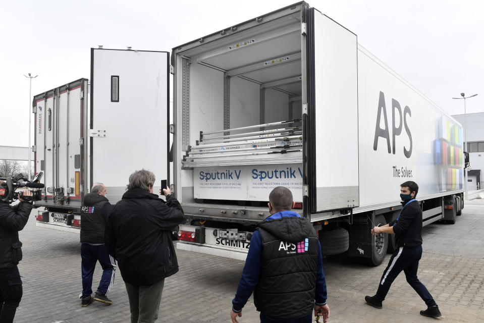 Boxes of Sputnik V vaccines are unloaded from a truck at a warehouse of Hungaropharma, a Hungarian pharmaceutical wholesale company, in Budapest, Hungary, Thursday, March 4, 2021. (Zoltan Mathe/MTI via AP)