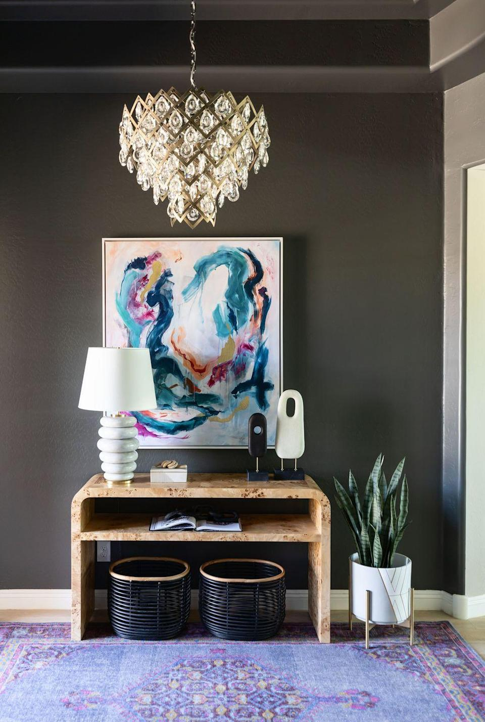 """<p>Sherwin-Williams' Forged Steel is a go-to choice for Lauren Lerner of <a href=""""https://www.livingwithlolo.com/"""" rel=""""nofollow noopener"""" target=""""_blank"""" data-ylk=""""slk:Living with Lolo"""" class=""""link rapid-noclick-resp"""">Living with Lolo</a>. """"I love that this color changes depending on the lighting and nearby hues,"""" she says. """"It is a warm gray with some brown tones and a great neutral to be used as a dramatic backdrop."""" </p><p><a class=""""link rapid-noclick-resp"""" href=""""https://www.sherwin-williams.com/homeowners/color/find-and-explore-colors/paint-colors-by-family/SW9565-forged-steel"""" rel=""""nofollow noopener"""" target=""""_blank"""" data-ylk=""""slk:SHOP NOW"""">SHOP NOW</a></p>"""