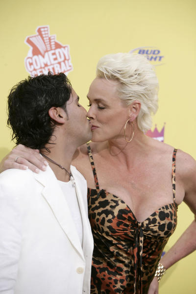 """FILE - In this July 22, 2007 file photo, Mattia Dessi, left, and Brigitte Nielsen arrive at the """"Comedy Central Roast of Flavor Flav"""" in Burbank, Calif. Nielsen says she has given birth at age 54. The model, actress and reality star and her 39-year-old husband Dessi released a statement to People magazine Saturday, June 23, 2018, saying their daughter Frida was born Friday in Los Angeles and weighed 5 pounds, 9 ounces. (AP Photo/Matt Sayles, File)"""