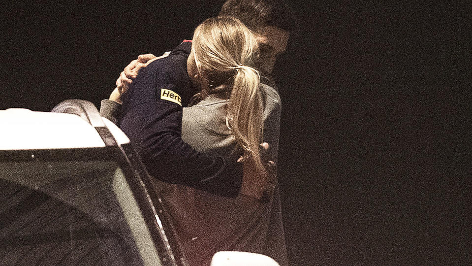 Sam Weideman, pictured here saying goodbye to his girlfriend before leaving Melbourne.