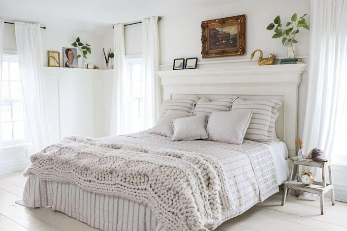 """<p>If your headboard mirrors a mantel, take the same styling approach. Greenery, artwork and a few decorative objects can easily do the trick. </p><p><b>RELATED: </b><a href=""""https://www.goodhousekeeping.com/home/decorating-ideas/g33418751/fall-mantel-decor-ideas/"""" rel=""""nofollow noopener"""" target=""""_blank"""" data-ylk=""""slk:30 Chic Fall Mantel Decor Ideas"""" class=""""link rapid-noclick-resp"""">30 Chic Fall Mantel Decor Ideas</a></p>"""
