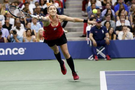 Bethanie Mattek-Sands of the U.S. returns a ball during her match with Serena Williams of the U.S. at the U.S. Open Championships tennis tournament in New York, September 4, 2015. REUTERS/Shannon Stapleton