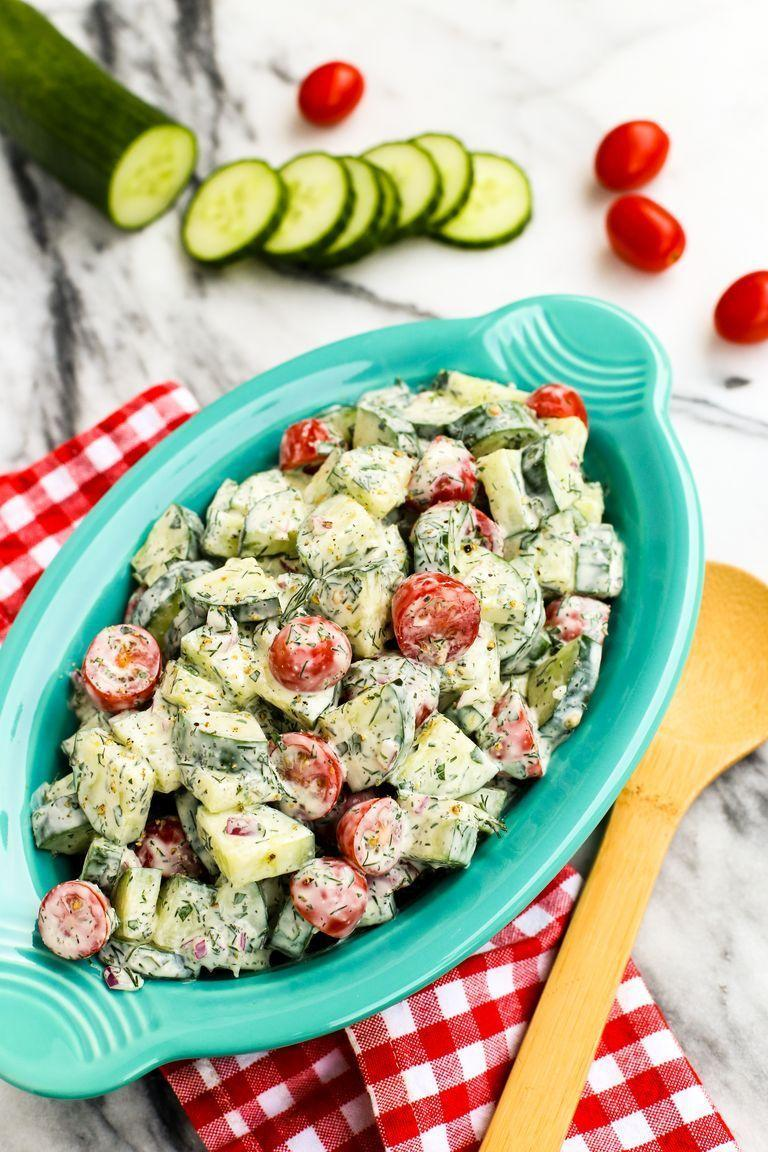 """<p>This simple salad is coated in a creamy herb dressing that's packed with fresh flavor from dill, mint, parsley, and basil. It's great alongside your favorite barbecue main dishes, too.</p><p><a href=""""https://www.thepioneerwoman.com/food-cooking/recipes/a78903/cucumber-tomato-salad-with-creamy-herb-dressing/"""" rel=""""nofollow noopener"""" target=""""_blank"""" data-ylk=""""slk:Get the recipe."""" class=""""link rapid-noclick-resp""""><strong>Get the recipe. </strong></a></p><p><a class=""""link rapid-noclick-resp"""" href=""""https://go.redirectingat.com?id=74968X1596630&url=https%3A%2F%2Fwww.walmart.com%2Fsearch%2F%3Fquery%3Dpioneer%2Bwoman%2Bcutting%2Bboard&sref=https%3A%2F%2Fwww.thepioneerwoman.com%2Ffood-cooking%2Fmeals-menus%2Fg36500577%2Ftomato-recipes%2F"""" rel=""""nofollow noopener"""" target=""""_blank"""" data-ylk=""""slk:SHOP CUTTING BOARDS"""">SHOP CUTTING BOARDS</a></p>"""