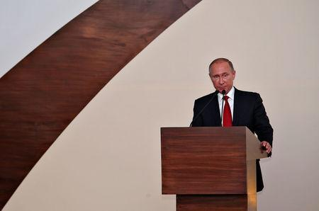 Russian President Vladimir Putin speaks during a joint news statement after India-Russia Annual Summit in Benaulim, in the western state of Goa