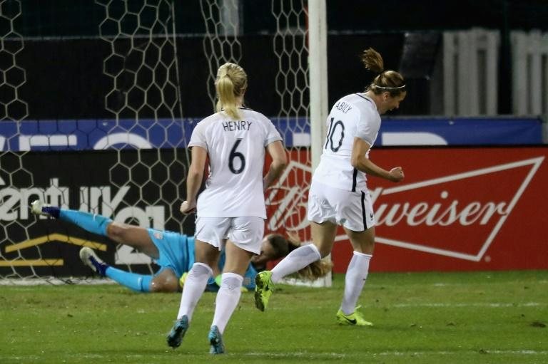 France got off to a dream start when Camille Abily (R) scored from the penalty spot after only eight minutes in a 3-0 win over the US to take the She Believes Cup