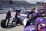 Denny Hamlin (11) gets service in the pits during the NASCAR Cup Series auto race at Martinsville Speedway in Martinsville, Va., Sunday, April 11, 2021. (AP Photo/Steve Helber)